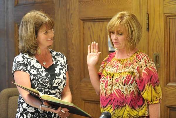 Kings Park School District clerk Patti Capobianco, left,
