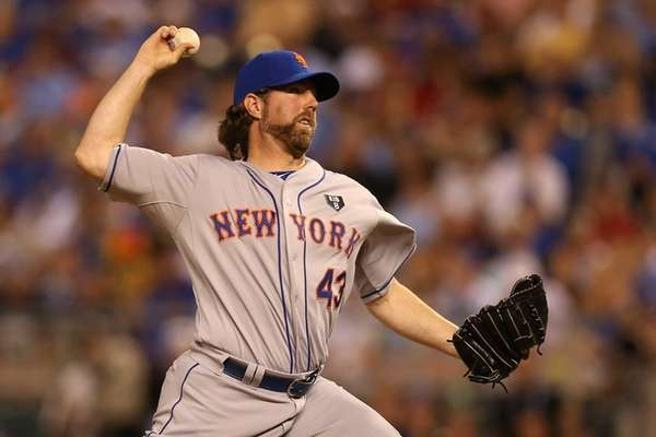 National League All-Star R.A. Dickey pitches during the