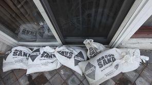 Sandbags rest against the rear sliding door of