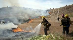 Firefighters from Los Angeles and Ventura counties put