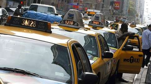 Taxi cabs line up a New York City