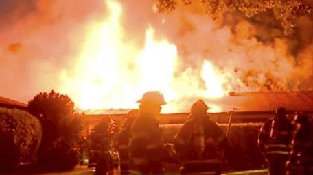 Two firefighters were hurt battling a fire at