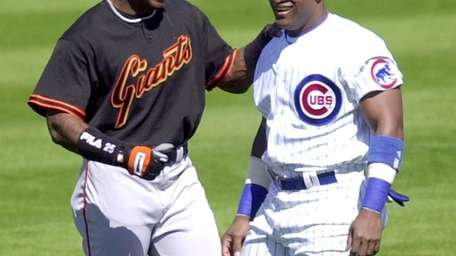 San Francisco Giants slugger Barry Bonds, left, and