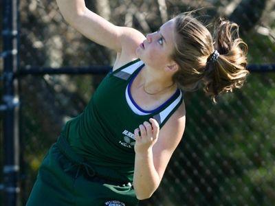 Katelyn Stabile of West Hampton smashes her serve