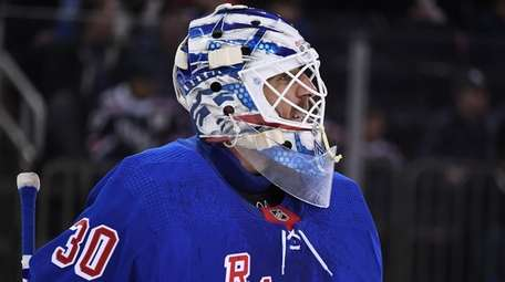 Rangers goaltender Henrik Lundqvist reacts after Bruins center