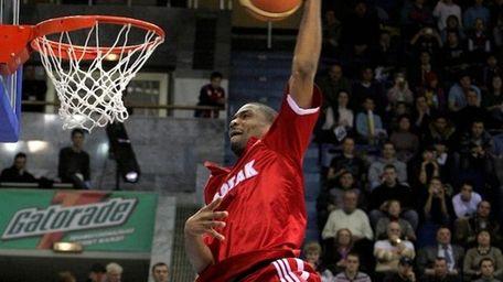 Spartak St. Petersburg's James White soars toward the