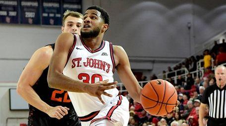 LJ Figueroa #30 of the St. John's Red