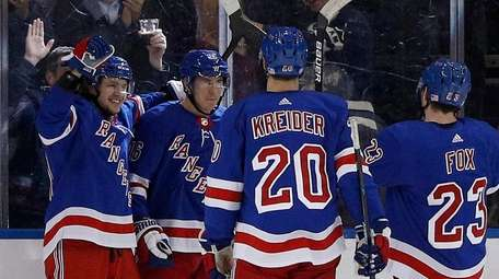 Ryan Strome #16 of the Rangers celebrates his