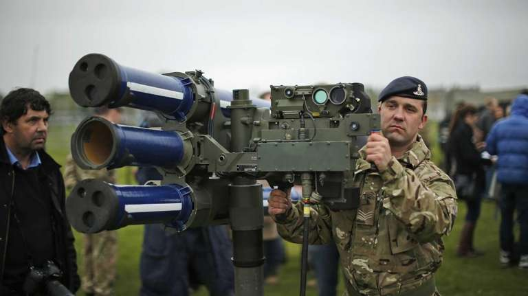Sergeant Craig from Britain's Royal Artillery regiment holds