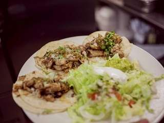 Chichimecas garnishes its traditional soft chicken tacos with