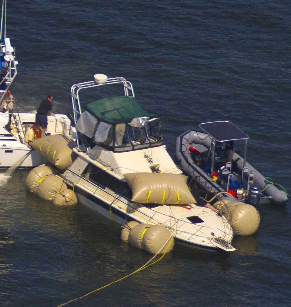 FBI divers and Nassau County police officers raise