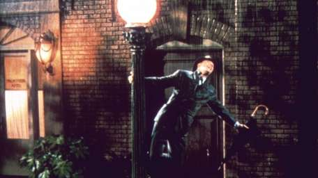 Gene Kelly does his iconic rain dance from
