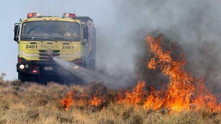 A U.S. Bureau of Land Management vehicle battles