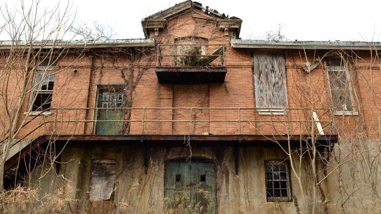 Building 123 sits abandoned with its roof collapsing
