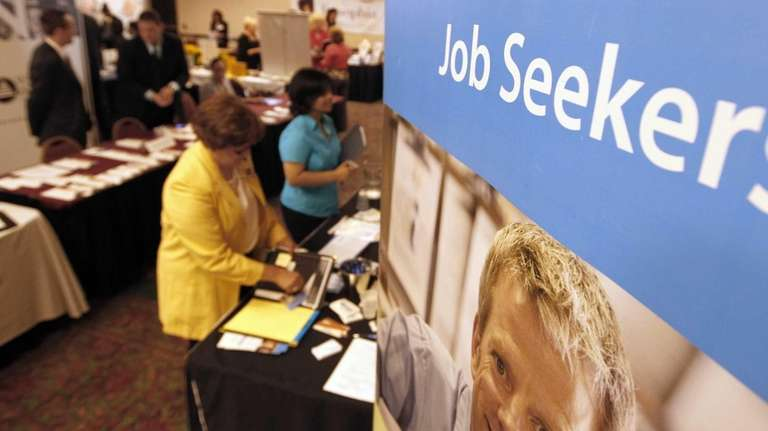 Job seekers visit recruiters at a jobs fair