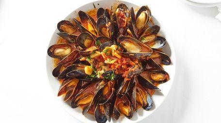 Cozze Posillipo are steamed mussels in a saffron-tomato