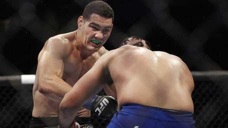 Chris Weidman, left, punches Mark Munoz during the