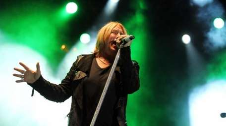 Joe Elliott performs with the band Def Leppard