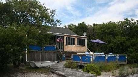 Accessible only by boat, this six-room beach house