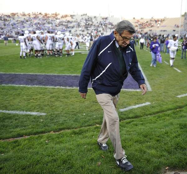 Penn State coach Joe Paterno walks off the