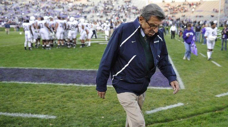 Penn State coach Joe Paterno walks off the