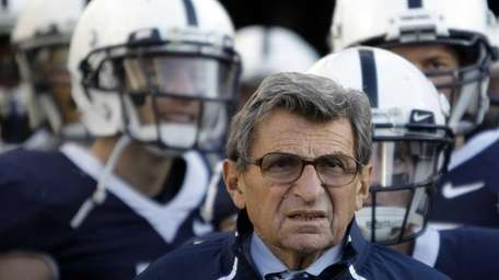 Penn State coach Joe Paterno stands with his
