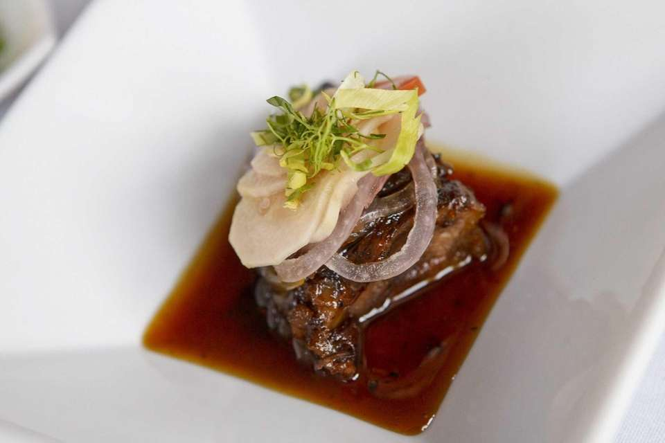 The antipasti include a braised short rib topped