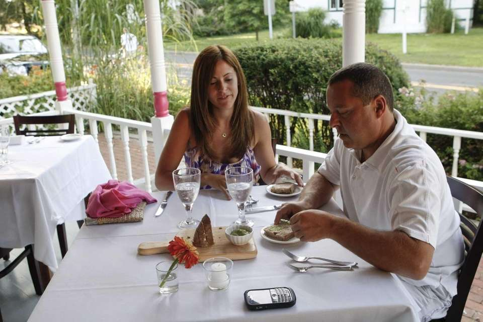 Shelter Island residents Elina and Dave Friezo dine