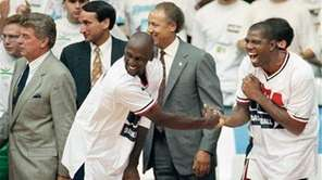 "USA's Earvin ""Magic"" Johnson, right, and Michael Jordan"