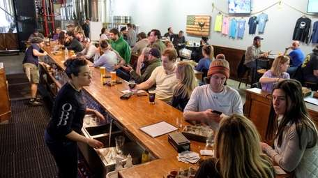 Patrons sip on a variety of beers in