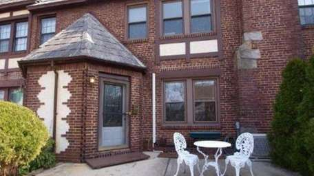 This attached brick Tudor at 388 Bauer Place