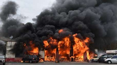 A major fire destroyed an autobody shop after