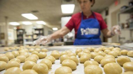 Maria Eftimiades makes Koulourakia cookies in preparation for