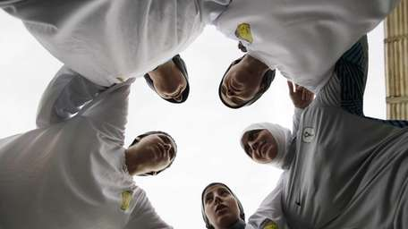 Members of a Saudi female soccer team listen