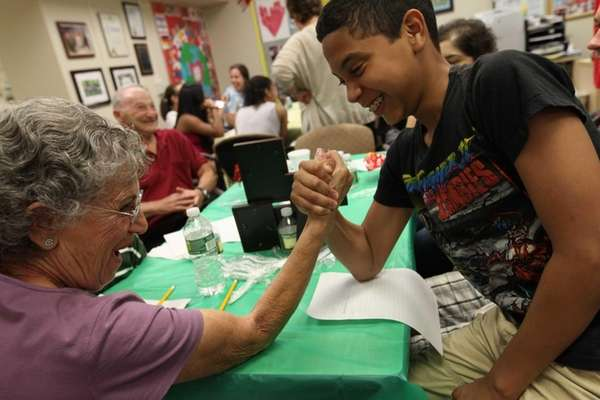 Volunteer Judie Horowitz enjoys friendly arm wrestling with
