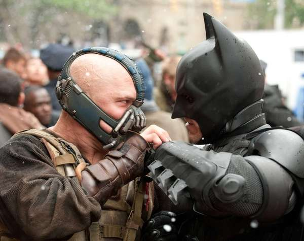 Tom Hardy as Bane and Christian Bale as