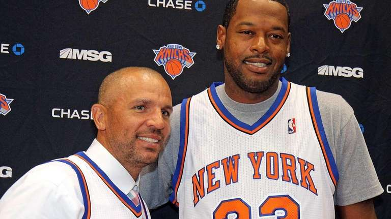 Jason Kidd, left, and Marcus Camby pose at