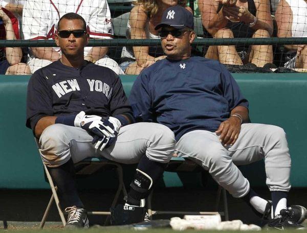 Yankees third baseman Alex Rodriguez, left, listens to