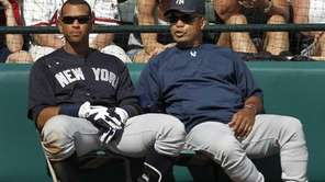 Yankees third baseman Alex Rodriguez, left, listens to