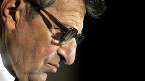 Former Penn State football coach Joe Paterno listens