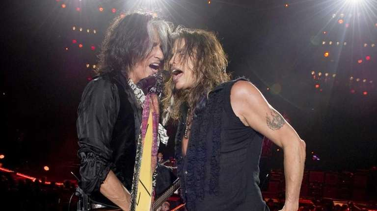 Steven Tyler (right) and Joe Perry perform with