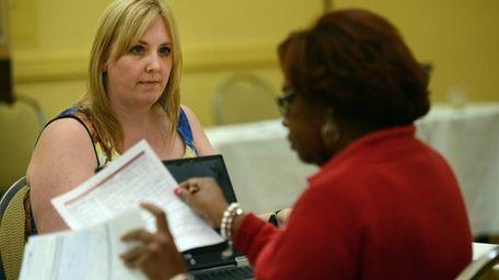 Kristen Burke of Ridge, left, meets with a