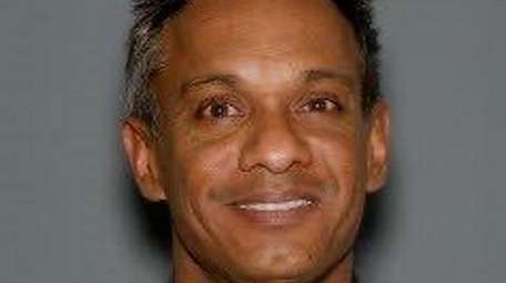 Dr. Tameshwar Ammar, 51, of Amityville, pleaded not