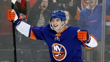 Noah Dobson #8 of the Islanders celebrates after