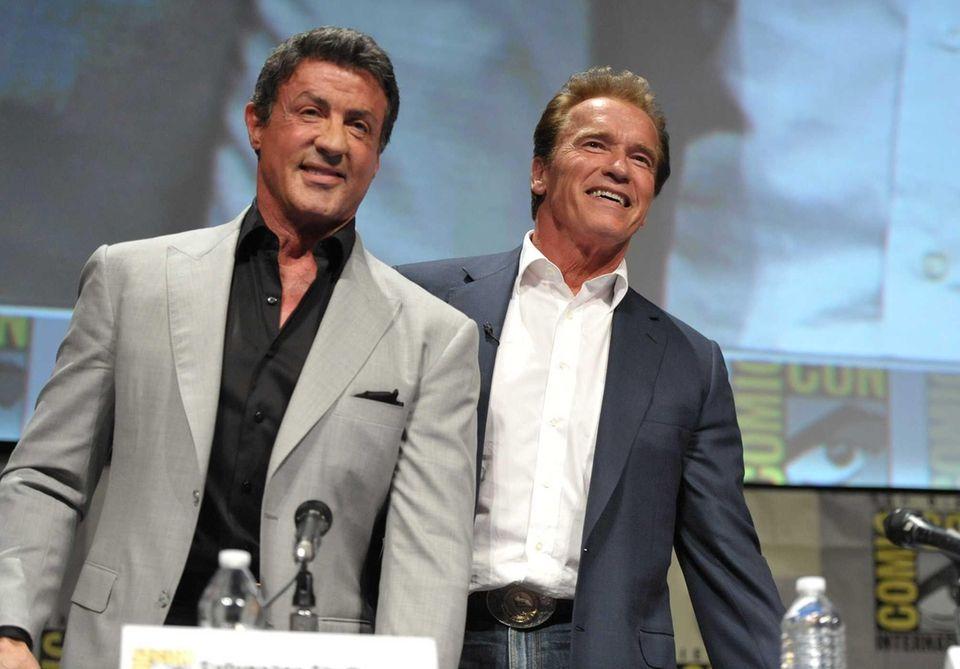 Sylvester Stallone and Arnold Schwarzenegger attend