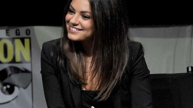 Actress Mila Kunis speaks at the