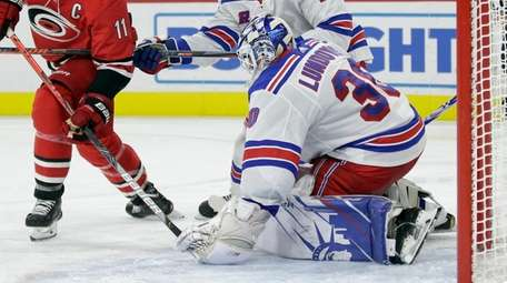 Rangers goaltender Henrik Lundqvist (30), of Sweden, blocks