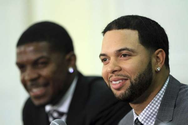 Deron Williams, right, and Joe Johnson smile during