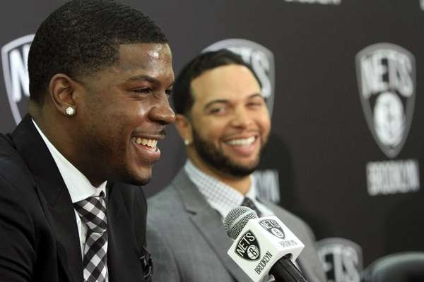 Joe Johnson, left, and Deron Williams smile during