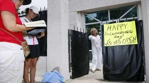 While abortion opponents pray, left, Jackson Women's Health